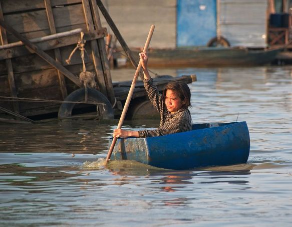 Blog Photo - FOTA Photo Comp Gabriela Surerus with Child in floating villages - Tonle Sap Lake