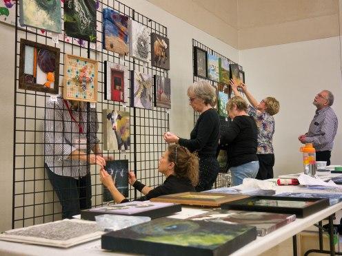 Blog Photo - FOTA Art Fair Exhibit - volunteers set up grids